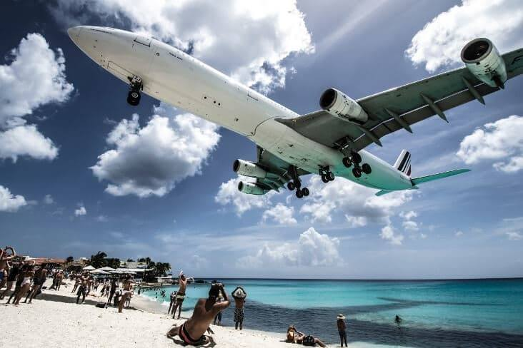 very low landing aircraft overflying the beach
