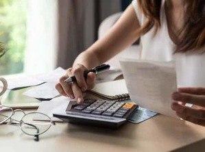 finance woman with calculator