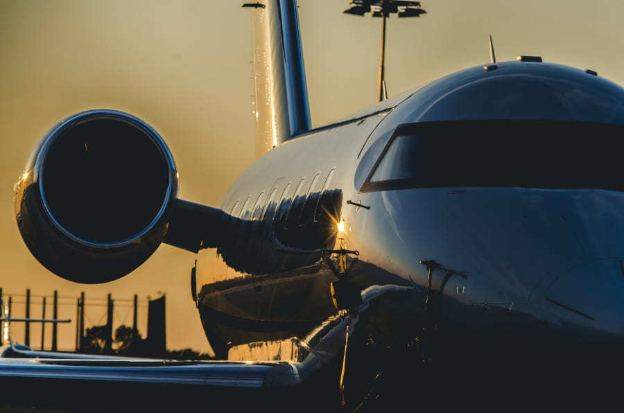 business jet during sunset
