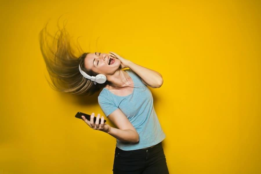girl listen to music with headphone