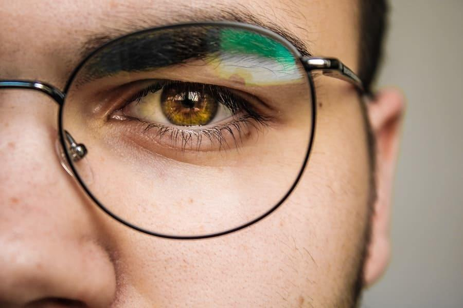 man with glasses close up