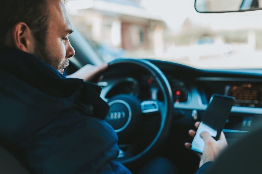 man with mobile in car