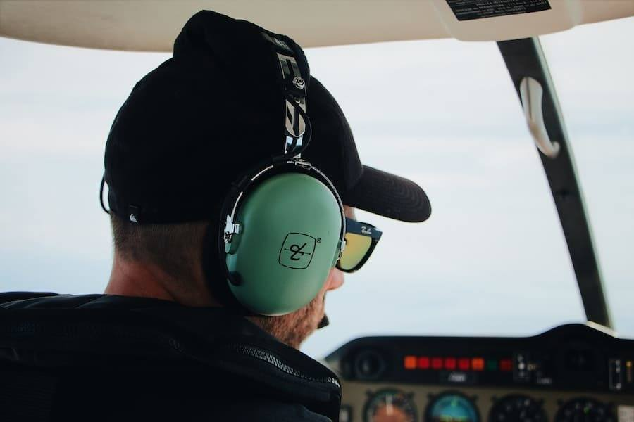 pilot with headset inflight